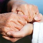 holding hands - daughter of dementia